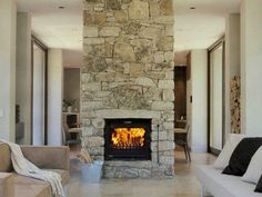 A fireplace is a must - I like how this separates the dining from the lounge.