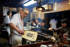 This chef has been working in the same yakitori bar for almost 50 years. check out the lamp above!!