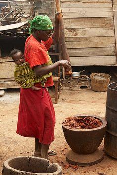 Woman crushing bark containing indigo dye