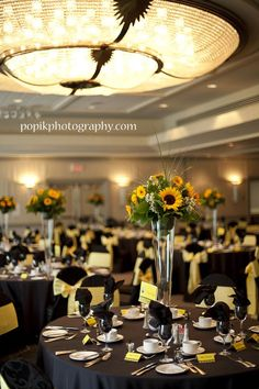 Sunflower themed wedding. The centerpieces and table settings are similar to what I have already!: