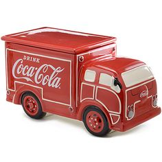 Coca-Cola Delivery Truck Cookie Jar, A ceramic cookie jar takes the shape of a mid-century delivery truck, painted bright red and with details for windows, tires, and lights.