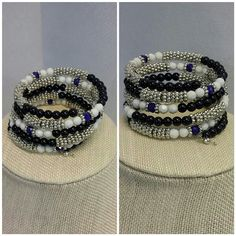 Navy n SilverTone Varying Size Round Ball Bracelet Navy, White and SilverTone Varying Size Round Balls Bracelet, wraps around wrist multiple times, stretchy, one size fits most, New With Tag, in bubble wrap plastic, 41% off new retail or $23.   ADD TO A BUNDLE! The Jewelry Bracelets