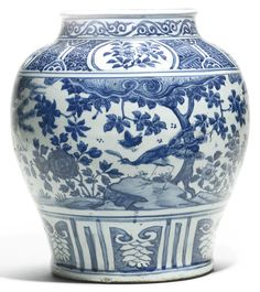 A Chinese blue and white baluster jar, Ming Dynasty, Wanli Period, the rounded sides rising from a tapered foot to a waisted neck and rolled rim, painted with a wide central band of a continuous scene of peacocks and birds in a garden under a tree and beside peony, with roundels of peony on a diaper ground at the shoulder, below a band of classic scroll at the rim and a band of lappets at the foot 35.5cm | Sotheby's