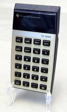 Vintage Texas Instruments Model TI-1025 LED Handheld Electronic Calculator, Made in the USA, Circa the 1970s.