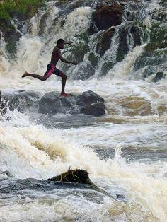 Boy jumping the Lobo Falls, Kribi, Cameroon. Photo: ToSStudio, via Flickr
