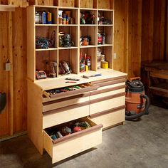 Neatly pack away most of your shop in this attractive tool storage cabinet, which features both shallow and deep drawers and adjustable open shelving.