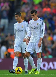 Gareth Bale (R) and Cristiano Ronaldo of Real Madrid CF react after Barcelona scored the opening goal during the La Liga match between FC Barcelona and Real Madrid CF at Camp Nou stadium on October 26, 2013 in Barcelona, Catalonia.