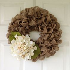 Beautiful and full Tan burlap wreath accented with cream hydrangeas. New- spring colors available