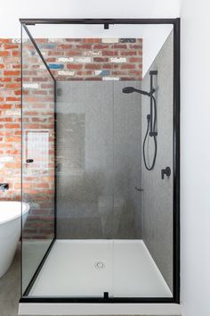 Black Semi-frameless shower with black hand shower and taps