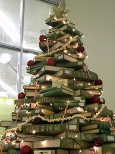 I am now on a mission to collect green covered books and make this my Christmas tree for every year. Book Christmas Tree, Book Tree, Christmas Morning, Little Christmas, All Things Christmas, Christmas Holidays, Merry Christmas, Christmas Decorations, Xmas Trees