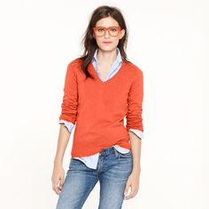 love this outfit combination. Bold colored v-neck sweater and neutral oxford button  down