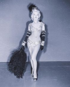 "1952. | William Travilla designed this costume for Marilyn to wear for her number ""Diamonds Are A Girl's Best Friend"" in ""Gentlemen Prefer Blondes."" However, after receiving publicity overdrive as a result of her nude photos, the studio deemed it too risqué and had Travilla design her a different dress instead, which became the classic pink dress we know today. ©MarilynNation"