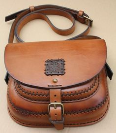 """The edging on this purse is """"slicked"""" and painted, nice job.  The stitching is by hand and rugged and rustic.  Well done.  https://www.etsy.com/shop/KNCustomLeather"""