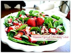 Summer Spinach Strawberry Salad -  gorgonzola, bacon, pecans, dried cranberries topped with a sweet balsamic dressing