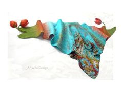 Felted Shawl, Felting Shawl, Nunofelt Wrap, Nunofelt Scarf, Wet Felt Scarf, Nunofelted Wrap, Floral Felt Scarf, Scarves Tulip, Fairy Scarf.  This wonderful Turquoise and Coral Nuno Felted Scarf for all seasons can be worn multple ways to give a different look, have fun and experiment with it yourself. The item is super soft made from 18 micron merino wool therefore will not itch the skin.  It is nicely and sits comfortably on your shoulders. Its a totally luxurious and romantic scarf that…