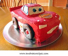 lightning mcqueen birthday cake, he looks funny, but the tires made from chocolate doughnuts is cool