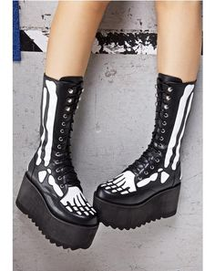 Current Mood Skin & Bones Boots have us shook to our skeleton. These cute 'N creepy boots feature a smooth vegan leather construction with sik white patent cut-outs of bones right down to yer toes, with a lightweight textured platform and front lace-up closure.