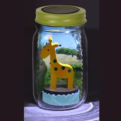 A solar-powered LED in the lid turns on automatically in the dark to magically light up the inside of the jar.  A fun decoration or nightlight for the shelf.