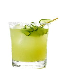 Cucumber-Jalapeno Margarita  Coarse sea or kosher salt 1 lime wedge ½ cup peeled, finely diced cucumber, plus a cucumber slice for garnish 4-6 thin jalapeño slices, with seeds ¼ cup cilantro sprigs ¾ oz (1½ Tbsp) fresh lime juice ¼ oz (1½ tsp) light agave nectar 2 oz (¼ cup) 100% blue agave silver tequila ½ oz (1 Tbsp) Cointreau or triple sec