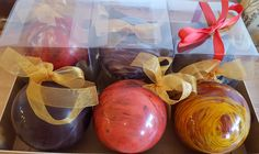 """A gift-boxed, beautifully hand-decorated Christmas bauble made of fine chocolate. Each bauble is 125 mm (ca. 5"""") in diameter, made of 75% single origin dark chocolate. They are hand-decrated with cocoa butter and edible food paint.Beautiful and jewel-like, you may hang it on your Christmas tree, or use them to decorate your Christmas table. They makes ideal gifts for your friends and family."""