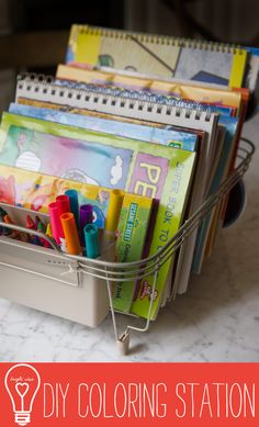 DIY Coloring Station - keep all of your coloring supplies in a dish rack! Could also be a cheap birthday or Christmas present, just fill the rack with a couple of coloring books and a pack of crayons from the dollar store and tie it up with some cellophane gift wrap!