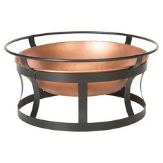 Roast marshmallows or warm up with a crisp cocktail around this iron fire pit, showcasing a chic open base.  Product: Firepit
