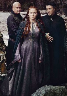 Varys, Sansa Stark and Petyr Baelish from the Vanity Fair magazine shoot.  This photo shoot is amazing! The little bird trapped between the spider and the mocking bird