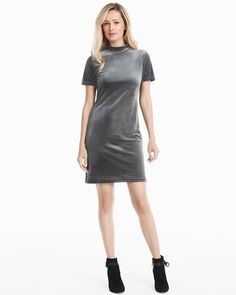 """Next-level velvet in shimmery gray adds a sumptuous update to your spring dress lineup. With a face-framing mock neck and short sleeves, our liquid velvet dress is especially perfect with our black chunky heel ankle boots.  Short-sleeve mock neck gray liquid velvet dress Lined Approx. 35"""" from shoulder; 4"""" above knee Polyester/spandex. Turn inside out; machine wash cold. Imported"""