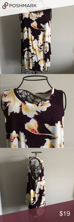 "Juicy Couture Maroon Flowered Tank, Medium Juicy Couture. New with tags. Dark maroon color. Beautiful, vibrant flower print. Shorter front Flowy layer. Size medium. 100% rayon. Measurements lying flat: armpit to armpit 19.5"" and length 26.5"".  ❌ No trades or off Poshmark transactions.   👌🏻Quick shipping.   💁🏻Offers welcome through ""Make an Offer"" feature.   👗👠 Bundle discount.   ❔ Feel free to ask any questions. Juicy Couture Tops"