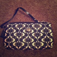 Coach wallet/wristlet! Cute and hardly used Coach wallet/wristlet! Only used for 2 weeks! No marks! **price is now firm** will take really reasonable offers** Coach Bags Wallets