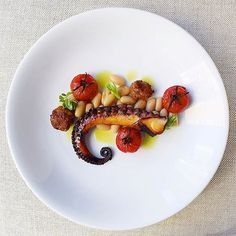 Foodstar Gayle van Wely Quan (@gayleq) shared a new image via Foodstarz PLUS /// Cabernet, Leek, Lemongrass Braised Seared Octopus with Chorizo, Garlic Cannelloni Beans and Blistered Tomatoes In Chive Oil  #octopus #leek #chorizo #beans #tomatoes #foodstarz  If you also want to get featured on Foodstarz, just join us, create your own chef profile for free, and start sharing recipes, images and videos.  Foodstarz - Your International Premium Chef Network
