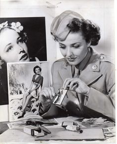 Text on the reverse: Nov 9  1944 > When screen star Laraine Day sends her cards to Servicemen overseas they are in for a pleasant surprise. Her cards are not of the usual variety. She has devised a novel idea for playing cards. On the backs of the cards Laraine has had imprinted a glamorous picture of herself, modeled along the linea of pin-up art. In costume, between scenes of her current film Women's Army, Laraine illustrates how she devised her novel cards.