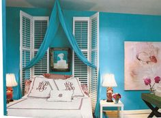Carribean blue bedroom with red accents