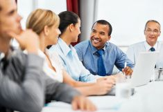 Group of businesspeople having a meeting stock photo