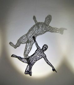 German artist Moto Waganari crafts intricate human sculptures using filigree wires, but there are hidden surprises in his works of wired art. The artist uses light to tease out the 'alter egos' of his sculptures, which splay out on the wall as dramatic, two-dimensional shadows.