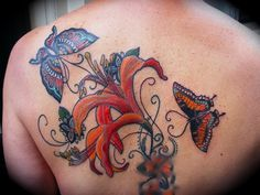 I tattooed Jacobean lilies on Esther's back..