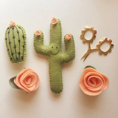 This four piece set includes two flower magnets, one happy cactus magnet and one small beaded cactus in the colors depicted in the image.
