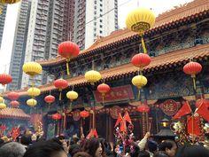 Prayers at a Hong Kong temple during Chinese New Year.
