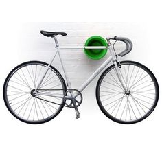 We use these Cycloc bicycle storage units in our office - they're great because they take up minimal space and are easy on the eye.