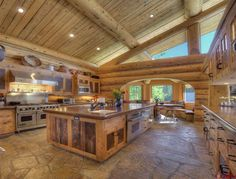 Enormous Rustic Kitchen!!!! I'd buy the house just for the kitchen, plus I like the dining area nook.