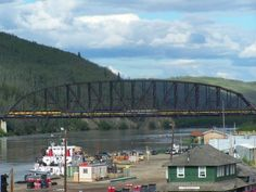Nenana is a village at the confluence where the tributary Nenana River enters the Tanana.  Mears Memorial Bridge was completed in 1923 as part of Alaska's railroad project and connected Fairbanks and Anchorage.  The train depot there was completed the same year. Longest truss bridge in America and its territories at the time.  Still 3rd longest in USA. slj