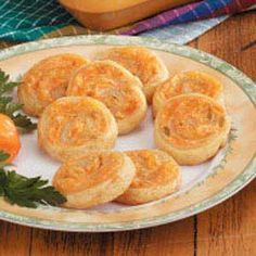 """Chili Cheddar Pinwheels Recipe -These baked Southwestern bites, made with crescent roll dough, will steal the show at your next get-together. """"They'll disappear in no time,"""" assures Mary Dorchester of Midland, Texas. Cream Cheese Crescent Rolls, Crescent Roll Dough, Crescent Roll Recipes, Recipes Appetizers And Snacks, Appetizer Dips, Appetizers For Party, Yummy Appetizers, Dinner Recipes, Desserts"""