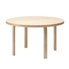 The Artek 90 Tables are a series of round tables that were designed by Alvar Aalto in 1935. They have L-shaped legs in natural lacquered birch and a top in either birch veneer, black linoleum or white laminate. The tables come in many different sizes.