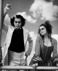Johnny Depp and Helena Bonham Carter as Sweeney Todd and Mrs. Lovett