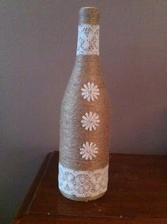 Brown twine wine bottle vase with white lace and by BottlesforYou Twine Wine Bottles, Wine Bottle Corks, Painted Wine Bottles, Bottles And Jars, Glass Bottle Crafts, Diy Bottle, Vase Design, Keramik Vase, Bottle Painting