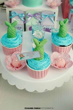 Mermaid tail cupcakes at a  Little Mermaid birthday party! See more party planning ideas at CatchMyParty.com!