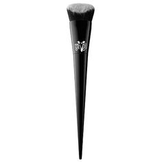 Shop Kat Von D's Lock-It Edge Foundation Brush at Sephora. Its sculpted shape conforms to the curves and contours of the face for precise application.