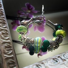 byoujewelsAn orchid that represent your elegance...the Green for your hope of...a crazy weekend!!!!! #madeinitaly #beads #byou #bracelet #charms #hope #weekend #orchid