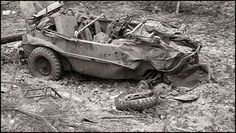 A severely damaged VW Type 166 Schwimmwagen sits abandoned after taking heavy punishment