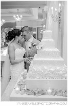The cutting of the wedding cake at Poinsettia Ballroom.  Destination Wedding at El Conquistador Resort & Las Casitas Village | Puerto Rico | ElConResort.com   Vanessa Velez Photography